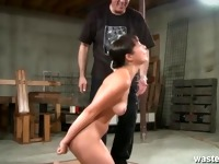 Her ass is left red raw after her master spanks her hard