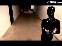 Blindfolded Girl In Latex Overal Spanked With Stick In The Dungeon