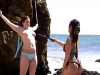 Girl Tied To Rocks Spanked Whipped By Mistress On The Beach