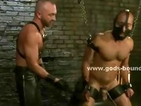 Sex slave in chains tied hard gets spanked before getting used as