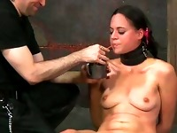 Caged beauty gets a whipping for her smooth wazoo
