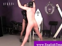 Dominatrix spanks bonded subject