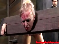 Blonde sub spanked in stocks