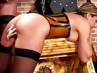 Busty blonde in corset and stockings spanked getting her pus