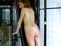 Beautiful slave with great body is spanked on her ass by ger