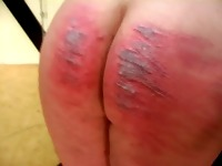 Military Dominatrix gives brutal caning